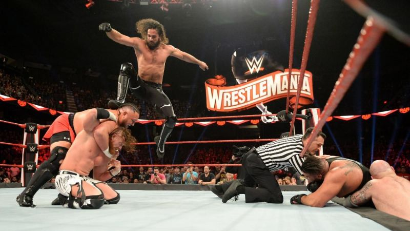 Seth Rollins putting the Stomp on Samoa Joe