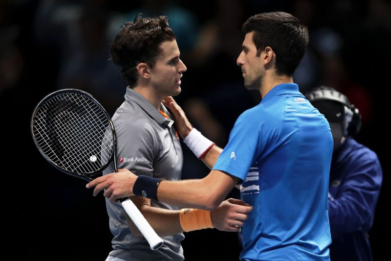 Dominic Thiem (L) and Novak Djokovic