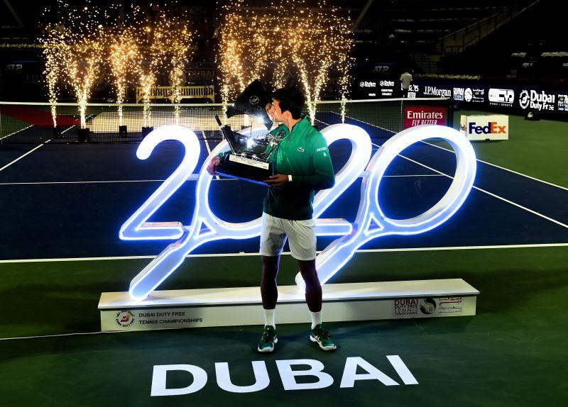Novak Djokovic with the Dubai Tennis Championship Trophy
