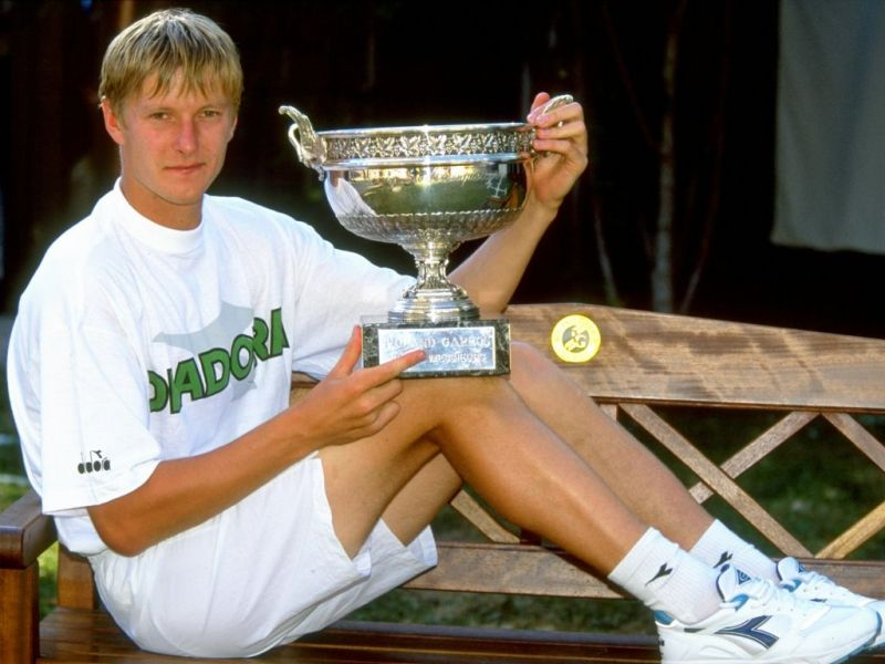 Yevgeny Kafelnikov poses with his second Grand Slam title at the 1999 Australian Open.