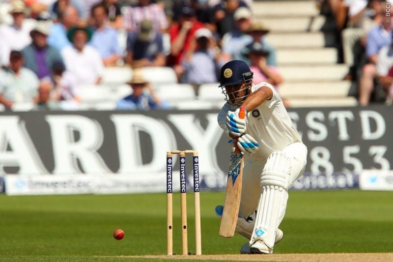 MS Dhoni leaning in to a cover drive