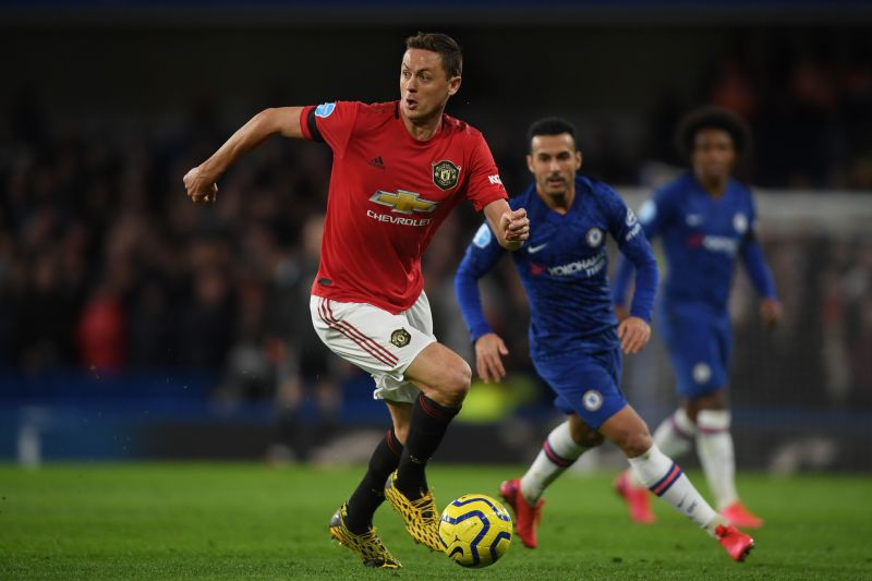 Nemanja Matic with the ball for Manchester United against his former club Chelsea at Stamford Bridge .