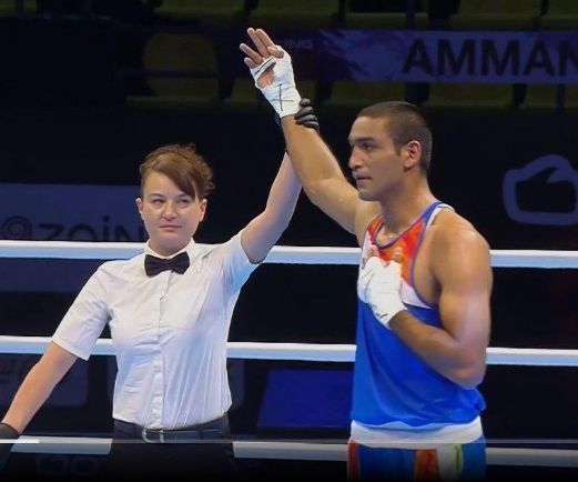 Ashish Kumar is through to the quarter-finals in the 75 kg weight category