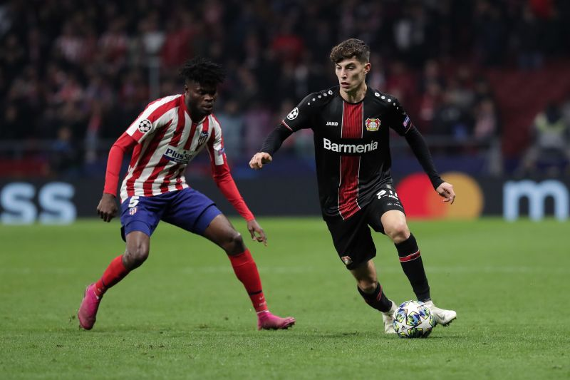 Kai Havertz taking on Thomas Partey in a group stage game against Atletico Madrid