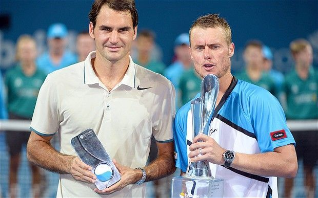 Federer lost to Hewitt (right) in the 2014 Brisbane final.