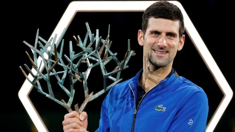 Djokovic hoists aloft his 34th Masters 1000 title at the 2019 Paris-Bercy Masters
