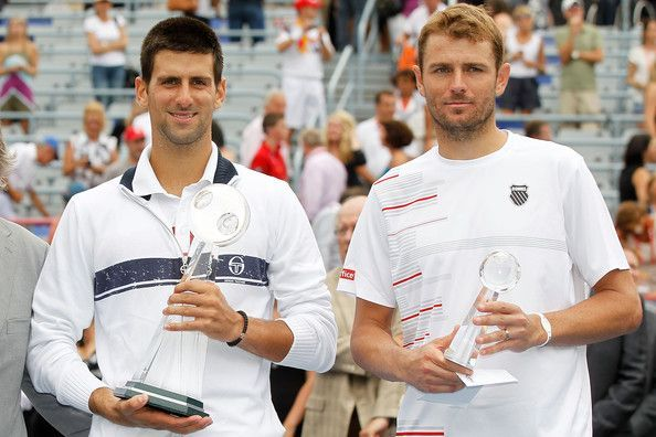 In his 4th Masters final, Mardy Fish (right) fell to Djokovic at the 2011 Coupe Rogers.