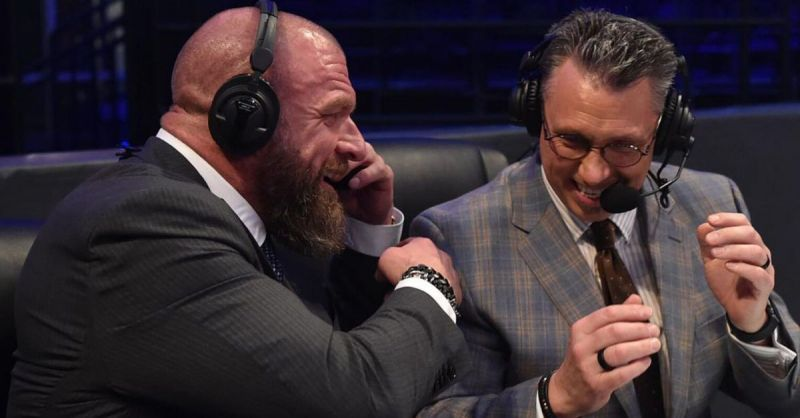 Triple H and Michael Cole.