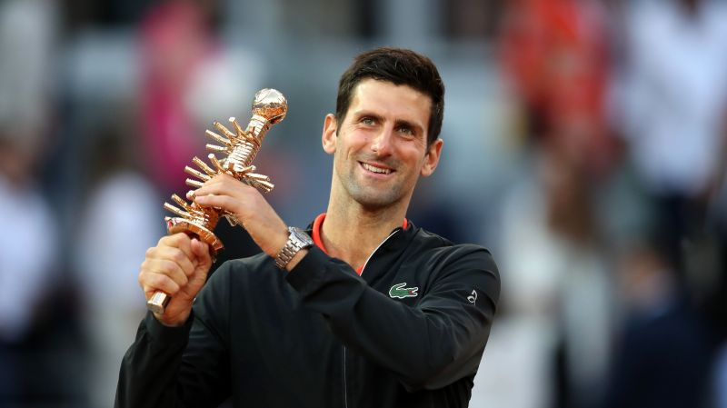 Djokovic celebrates his 33rd Masters 1000 title at 2019 Madrid.