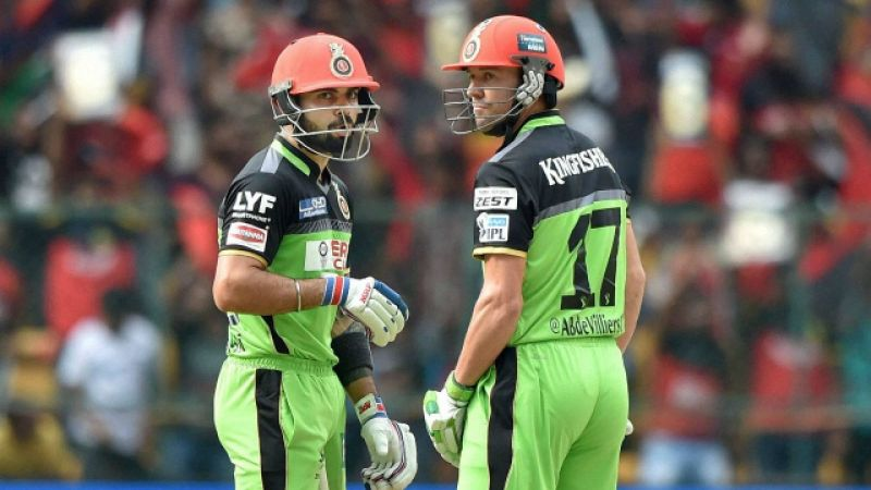 Virat Kohli and AB de Villiers sporting the green RCB jersey