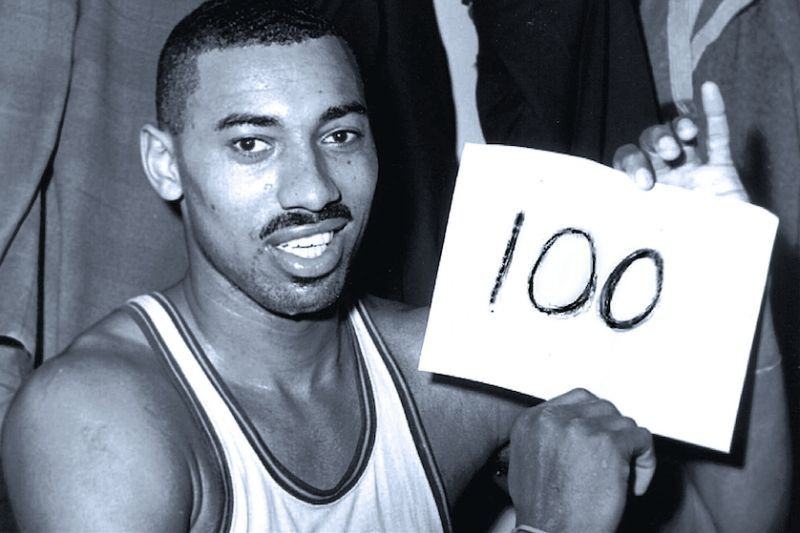 The iconic image of Wilt Chamberlain scoring 100 points vs the New York Knicks.