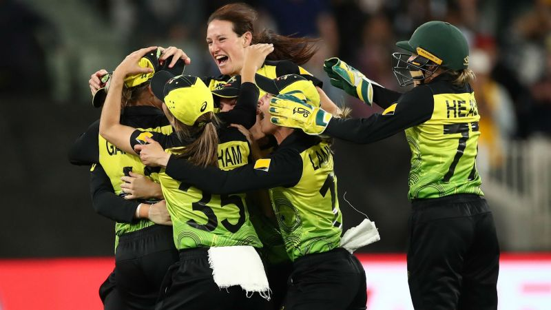 Australia celebrate after wrapping up victory over India at the MCG.