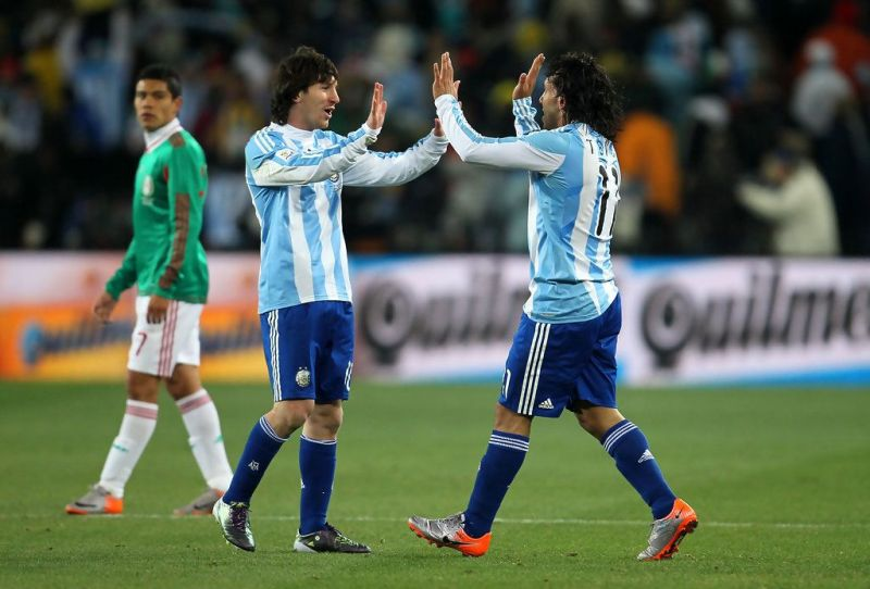 Carlos Tevez (right) scored a fragrantly offside goal for Argentina against Mexico in the 2010 World Cup