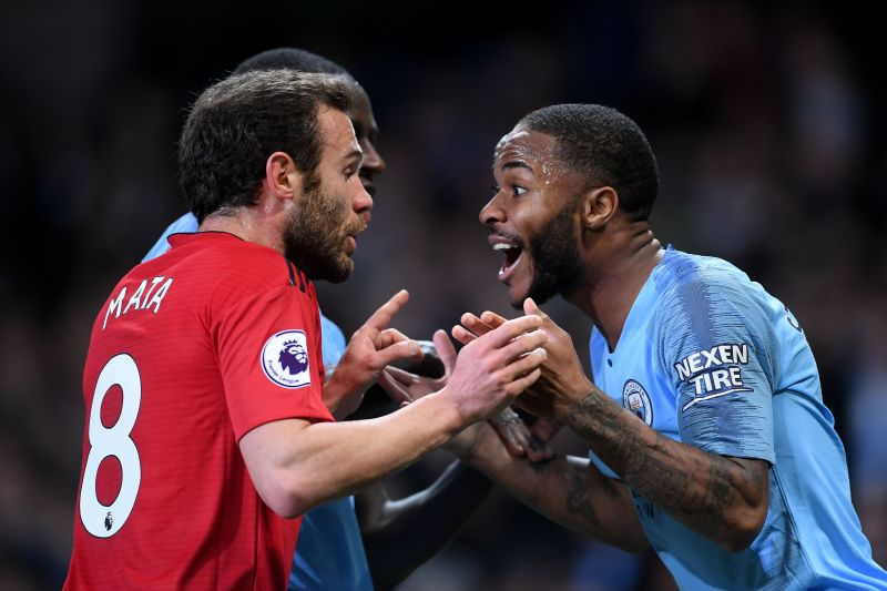Juan Mata (left) and Raheem Sterling (right) arguing during the December Manchester derby