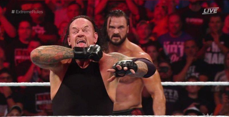 Drew McIntyre looms behind The Undertaker.