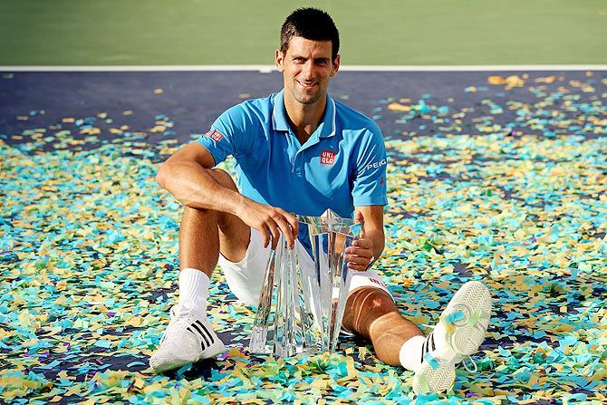 Djokovic poses with his 5th Indian Wells title in 2016.