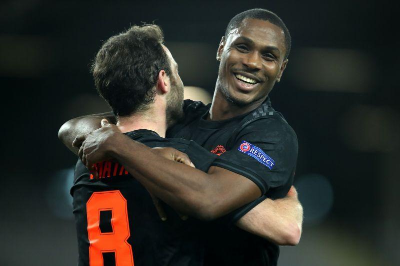 Ighalo celebrates a goal with Juan Mata.