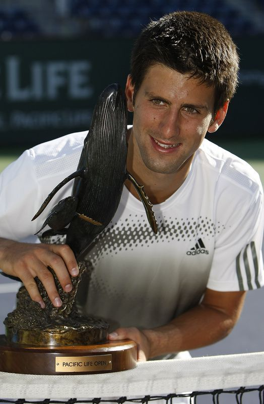 Djokovic poses with his first Indian Wells title in 2008.