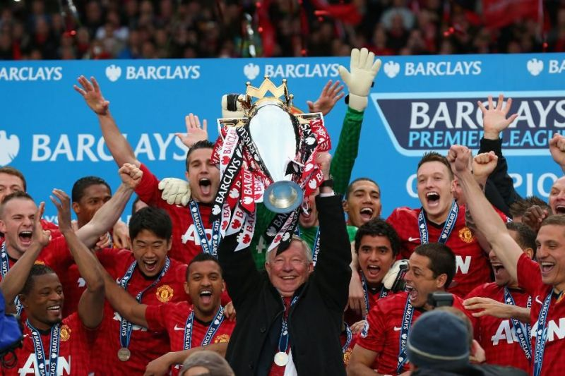 Sir Alex Ferguson lifts the Premier League title for the final time in his career in 2012-13.