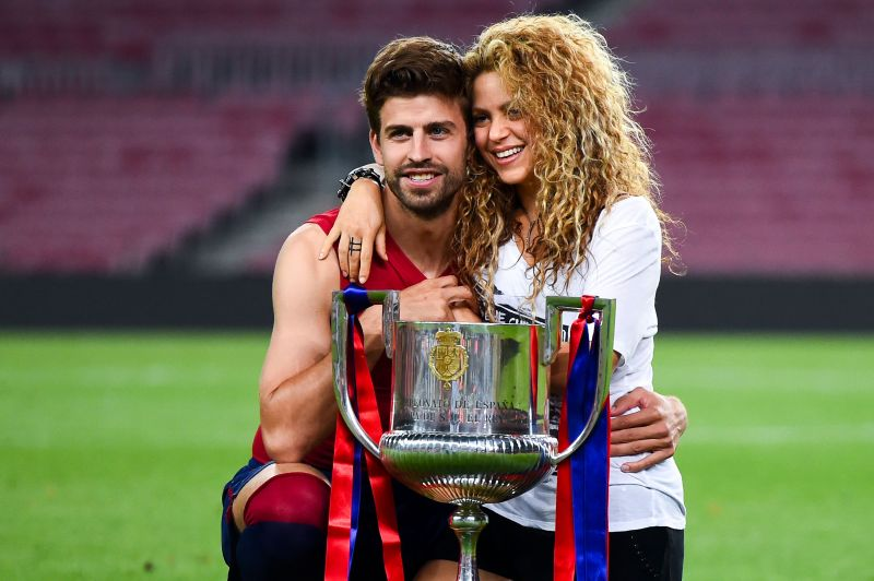 Gerard Pique and Shakira strike a pose with the Copa del Rey title
