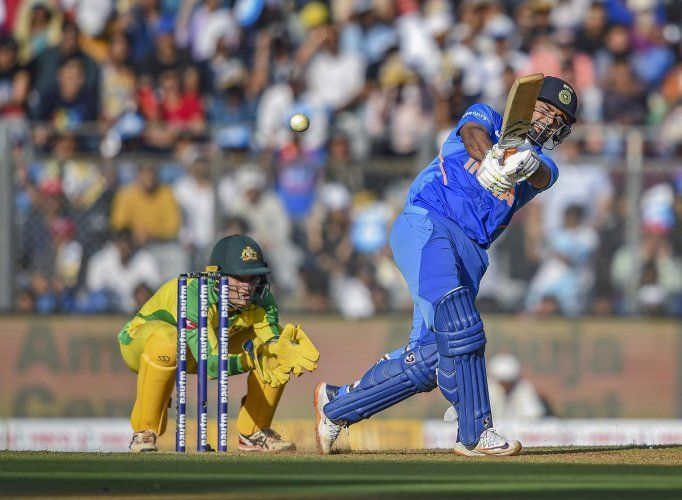 A One Day International match between India (blue) and Australia.