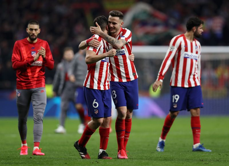 Atletico Madrid players celebrate their first leg win against Liverpool.