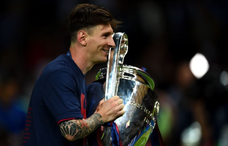 Lionel Messi poses with the UEFA Champions League trophy