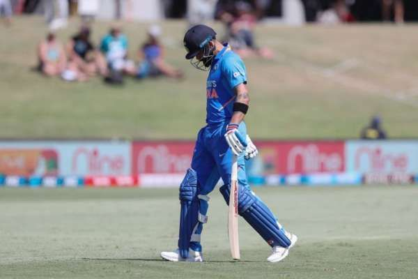 A desolate Kohli walks back after his dismissal