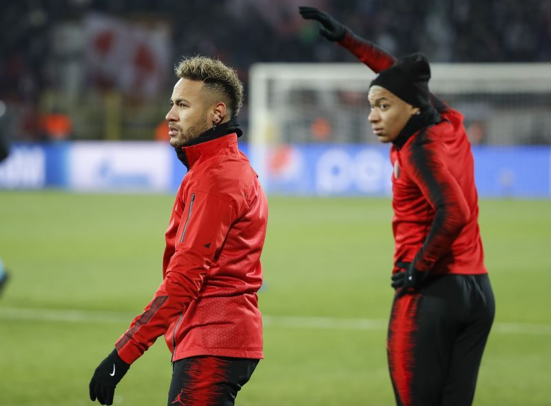 Neymar and Mbappe warming up