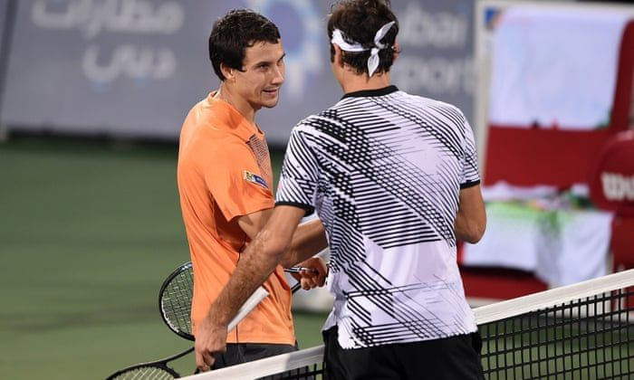 Evgeny Donskoy(right) stuns Federer in the second round of the 2017 Dubai Open.