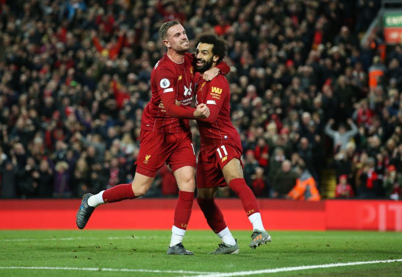 Salah celebrates with Jordan Henderson after scoring the winner against Tottenham
