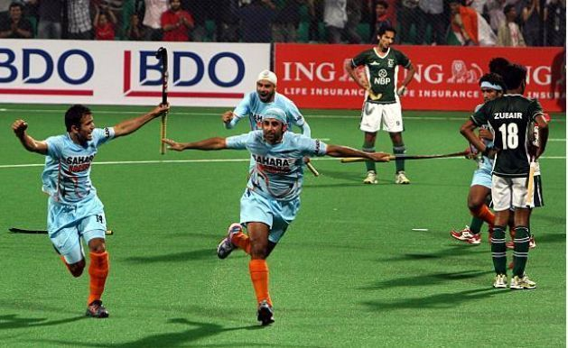 Prabhjot Singh celebrates with his team mates after scoring against Pakistan in India