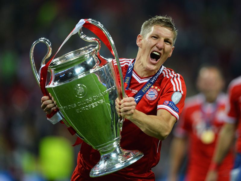 Bastian Schweinsteiger with the UEFA Champions League trophy