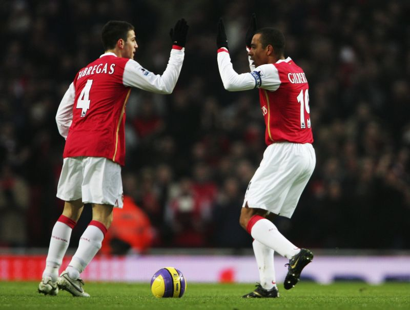 Fabregas celebrating with Gilberto Silva during their time together at Arsenal