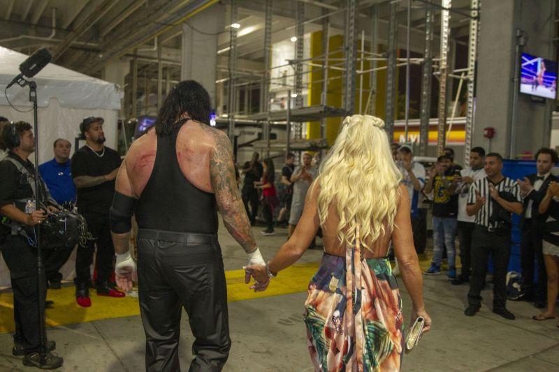 Undertaker and McCool walk hand-in-hand