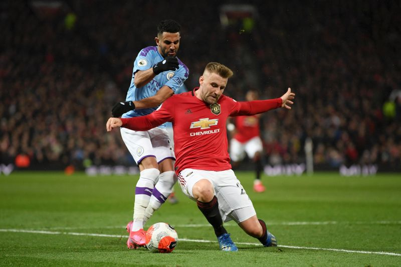 Luke Shaw vying for the ball with Riyadh Mahrez in the recent Manchester Derby
