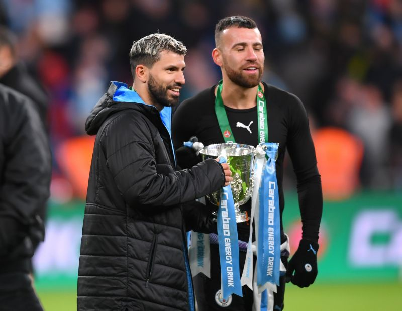 Otamendi poses for pictures with compatriot Sergio Aguero after their Carabao Cup victory in February