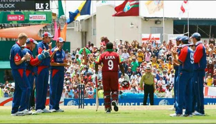 The English team with a guard of honour for Brian Lara