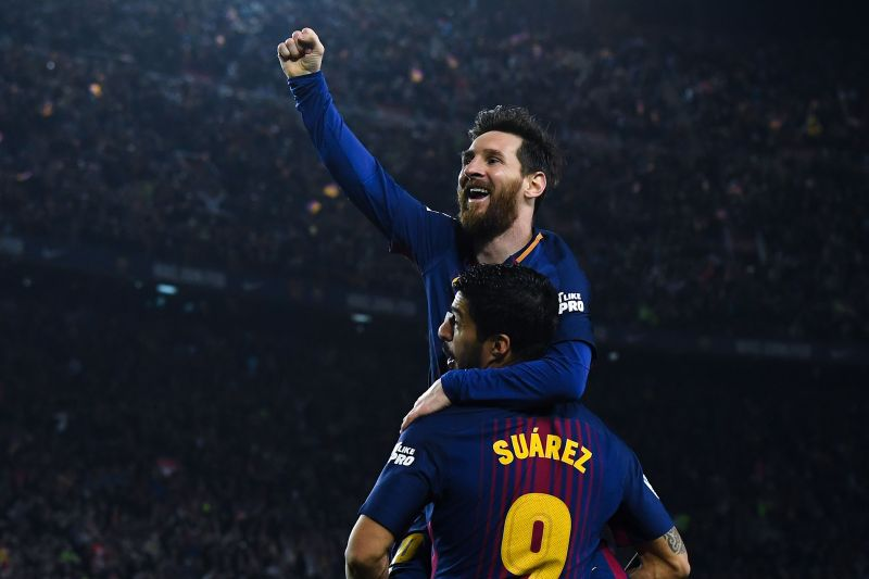 Lionel Messi and Luis Suárez in action for Barcelona