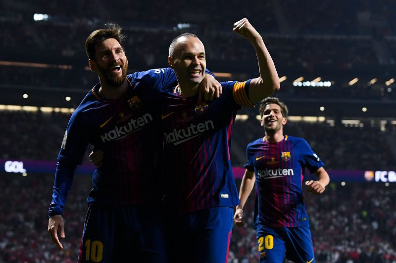 Iniesta and Lionel Messi for Barcelona