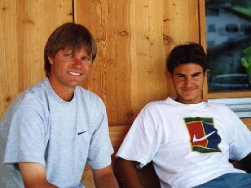 A young Roger Federer with coach Peter Carter