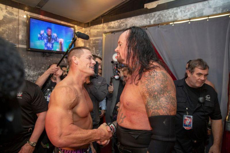 Undertaker and John Cena embrace after their match