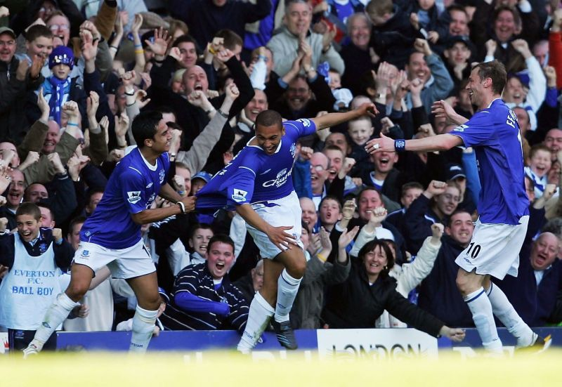 Vaughan celebrates his goal against Crystal Palace with Tim Cahill and Duncan Ferguson at Goodison
