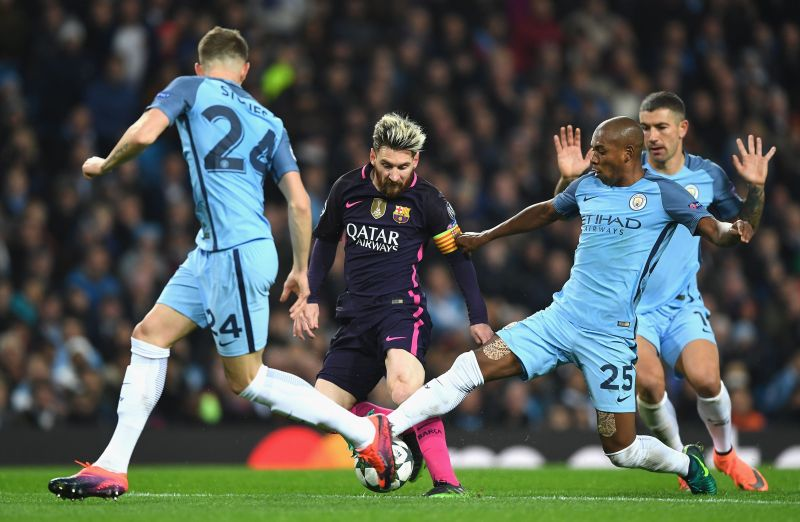 Lionel Messi battles it out with Fernandinho.