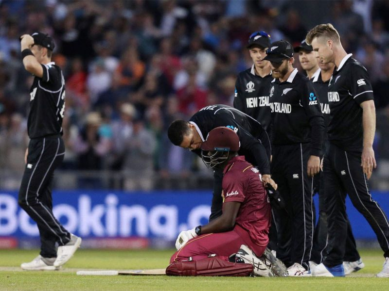 NZ players consoling the devastated Carlos Braithwaite after his exceptional effort.