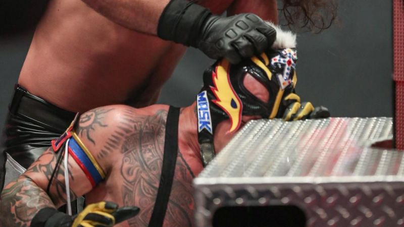 Rey Mysterio suffered an eye injury when Seth Rollins shoved his face into the corner of the steel ring steps (Image: WWE)