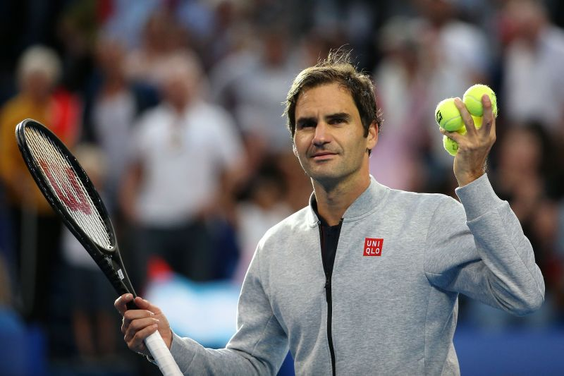 Roger Federer gets ready to toss a ball into the crowd