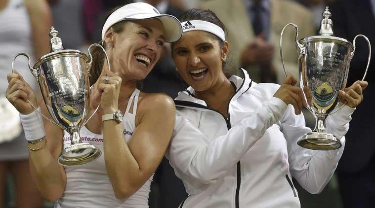 Sania Mirza poses with Martina Hingis after winning the 2015 Wimbledon doubles title