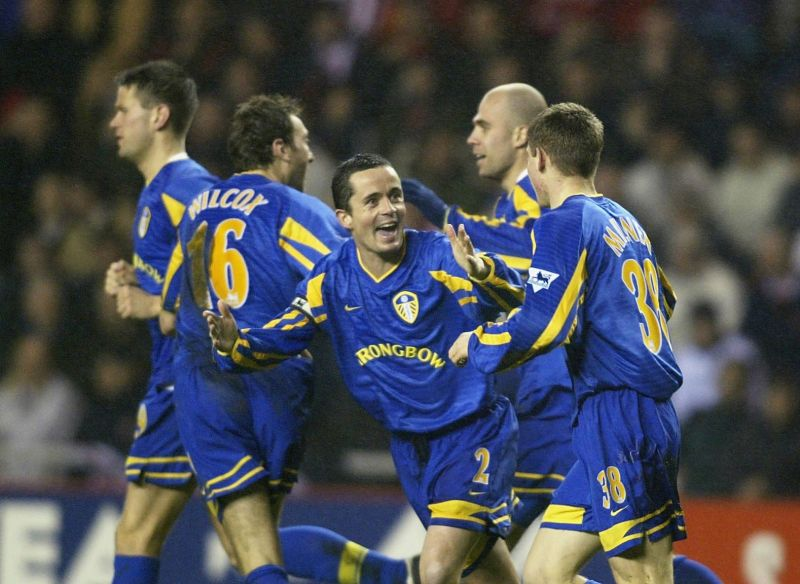 James Milner celebrates with his Leeds teammates after breaking the Premier League record