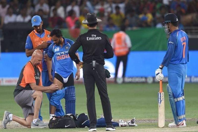 Kedar Jadhav receiving treatment after pulling his hamstring